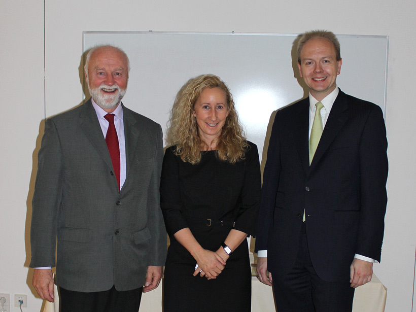 Dr. Thorben Finken with Globe Business College staff